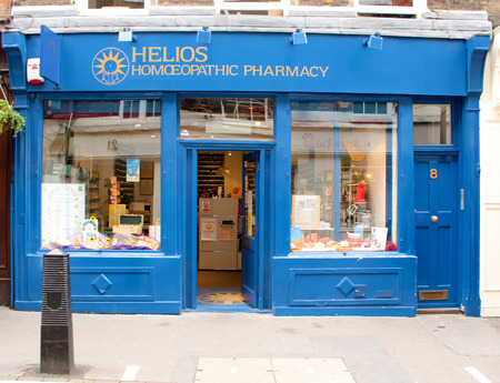homoeopathic: London, UK - August 17, 2010: empty Homoeopathic Pharmacy along London street