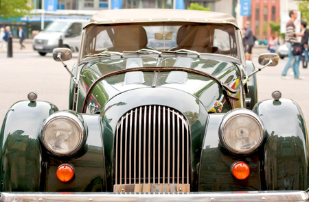 oldstyle: vintage oldstyle car in the city with defocused background Stock Photo