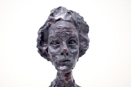 metal sculpture: Woman head bronze metal sculpture.