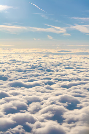 Flying in the sky over the clouds.