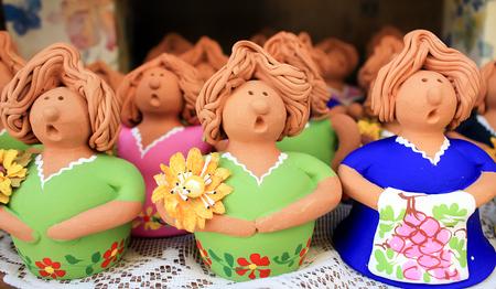 terracotta: Terracotta colored dolls.
