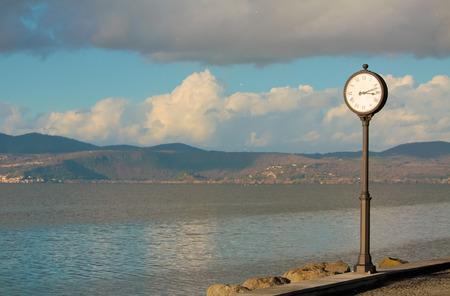 lazio: Pole clock and lake panorama in Anguillara Sabazia (Italy, Lazio)