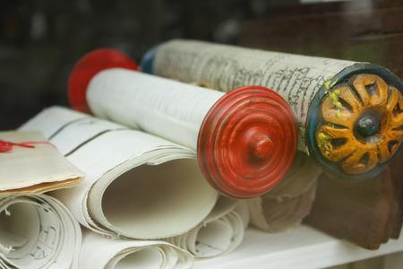 antique parchments on a shelf. Stock Photo