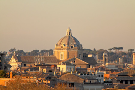 View of Rome roofs: Chiesa del Gesù Dome (Jesuss Church) and Collegio Romano Tower. Stock Photo