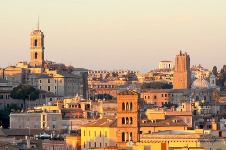 View of Rome roofs: Palazzo Senatorios Tower, San Giorgio in Velabro Basilicas Towerbell, San Luca and Martinas Church Dome, Torre delle Milizie (Roman Armys Tower) and Rospigliosi Palace.