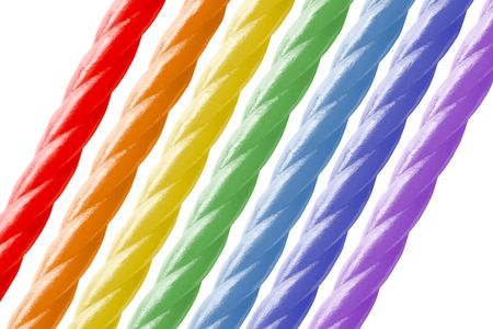 liquorice: rainbow sweety sticks oblique layout with copy space. Stock Photo