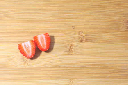 sliced strawberry on bamboo.