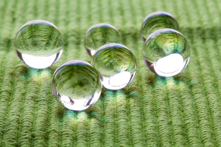 transparent globe: Water Pearls on cloth.