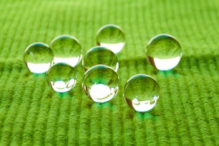 gel capsule: Water Pearls on cloth.