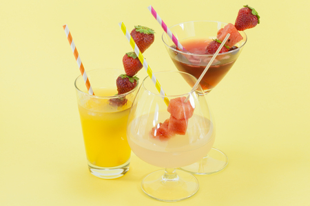 refreshing drinks on colored background.
