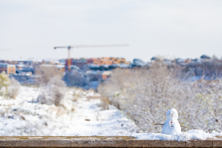 Single Tiny Snowman after snowfall in Rome
