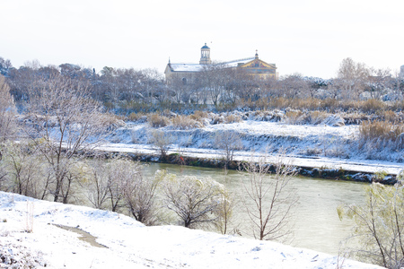 Tiber view with Saint Paul Cathedral in Rome after snowfall Фото со стока