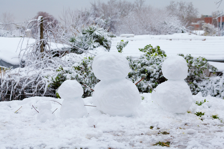 Snowmen family in Rome after a long snowfall Фото со стока
