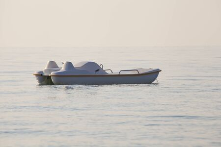 Empty pedal-boat floating alone in the sea