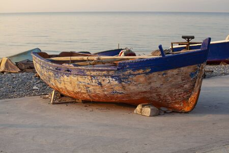 Very old fishing rowing boat on the beach (out of water)