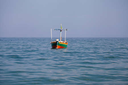Fisherman empty barge floating in the sea (no people around) Фото со стока