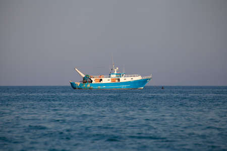 Fishing boat moored offshore daylight (no people around)