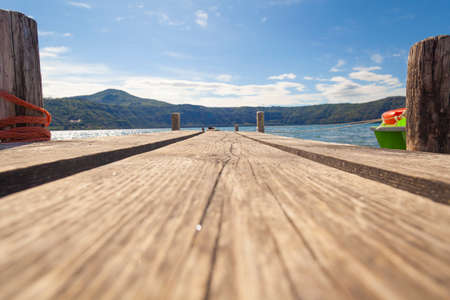 Empty pier at lake (camera on the ground)