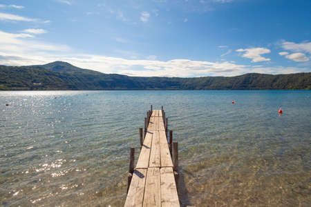 Empty pier at lake in a sunny day (Italy)