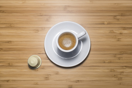 tilt view: Cup of coffee with a capsule, tilt view