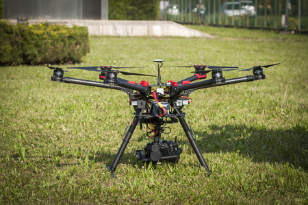 landed: Drone landed on grass Stock Photo