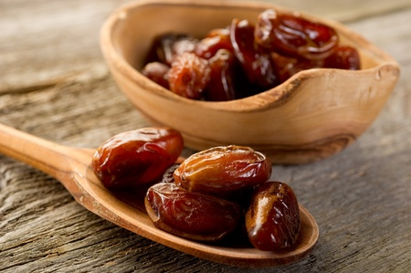 dates sugar over wood spoon