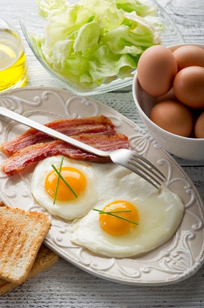 eggs with bacon and toasted bread photo