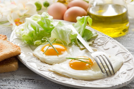 eggs with green salad on dish photo