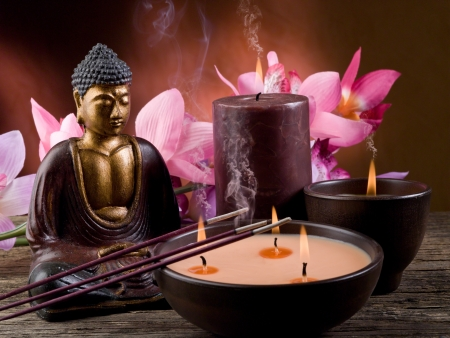 buddha face: buddha with candle and incense Stock Photo