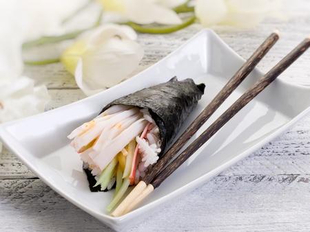 temaki sushi with chopsticks photo
