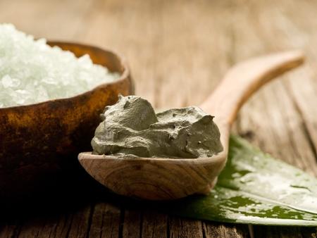 spa treatment: bath minerals and mud wellness concept