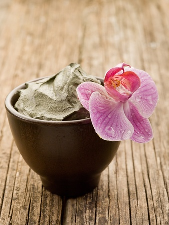 spa mud: mud and orchid natural wellness spa concept