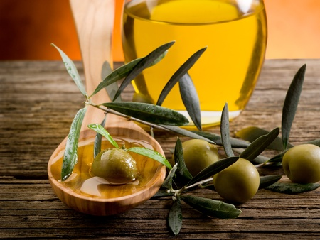 olive oil over wood spoon Stock Photo - 9804972