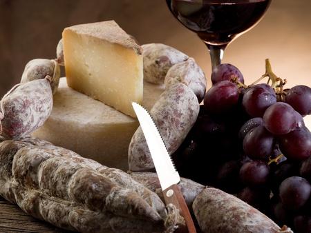 cheese salami grapes and redwine photo