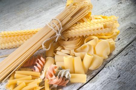 raw pasta on wood background photo