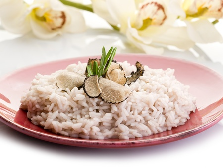 rice with truffle over red dish photo