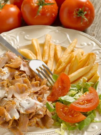 turkish bread: kebap with salad and potatoes on dish