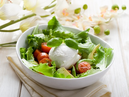 salad dressing: whole mozzarella with green salad,tomatoes and avocado