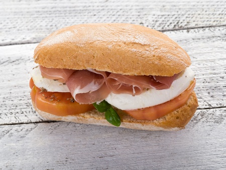 sandwich with parma ham mozzarella and tomatoes photo