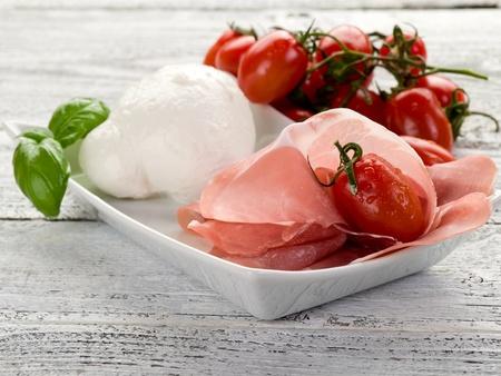 parma ham with mozzarella and tomatoes photo