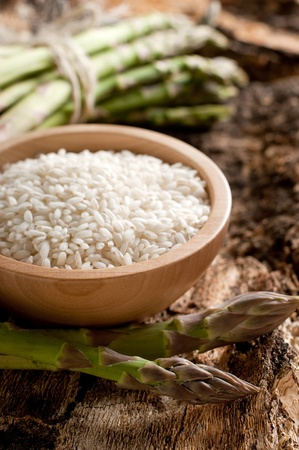 raw rice with raw asparagus photo