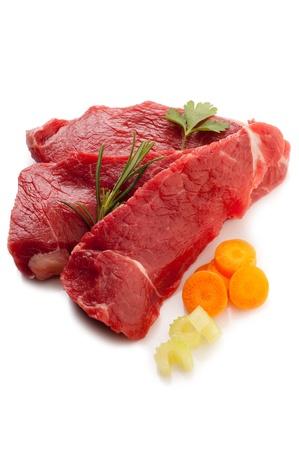 raw steak with ingredients photo