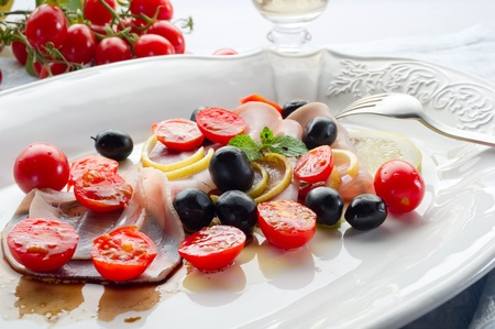 swordfish carpaccio with sliced tomatoes photo
