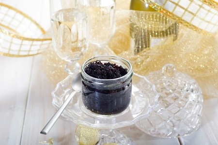caviar on cristal bowl and champagne photo