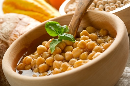 chickpea: chickpeas soup on wood bowl