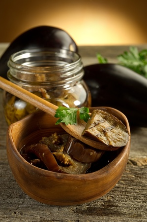 spoon with grilled eggplants preserved  photo