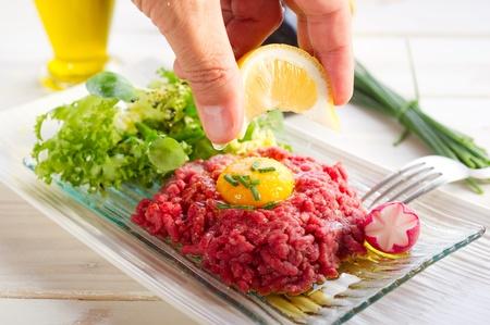 lemon over tartare meat Stock Photo - 10250690