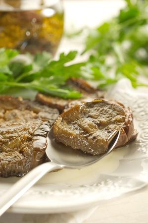 grilled eggplants   over spoon photo
