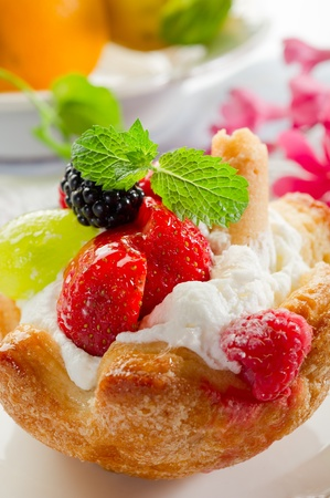 sweet pastries: fruits dessert with ice cream and cream sauce