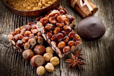 brittle: hazelnut brittle on wood with ingredients
